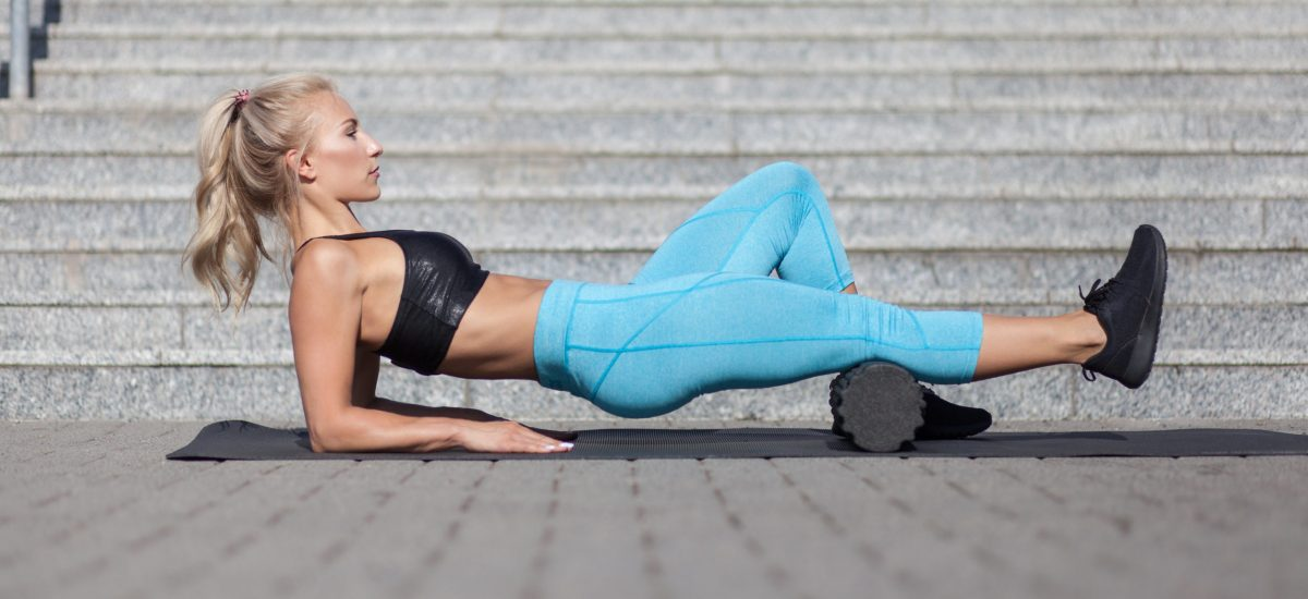 Female,Athlete,Exercising,With,Fascia,Roll